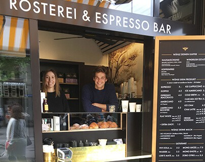 coffee shop, coffee window, two barista smiling, zurich, bahnhofstrasse