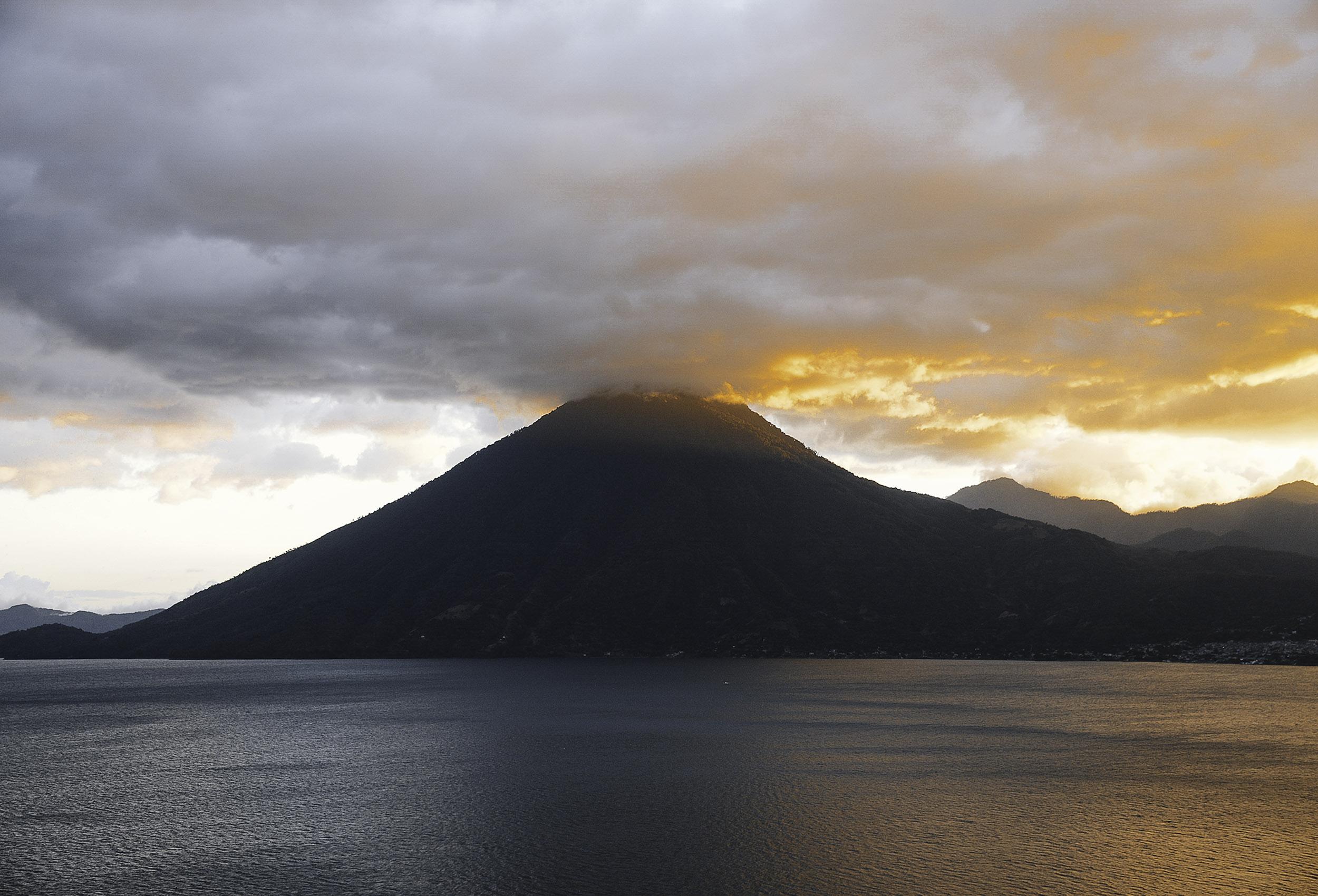 lake of atitlan with volcano in guatemala