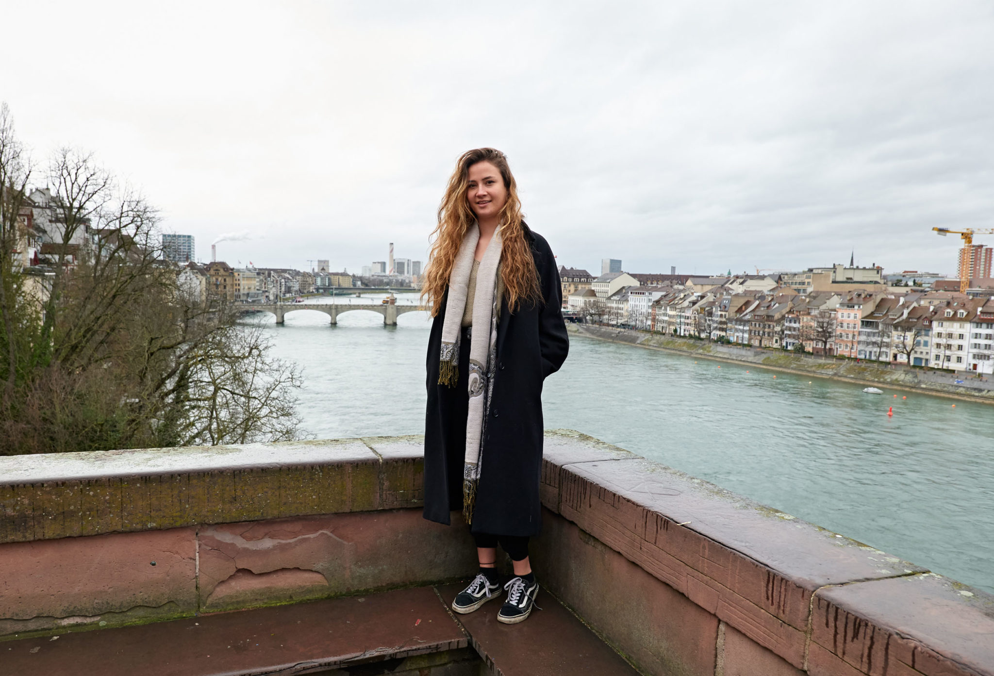 portrait of a vicafe barista in front of the rhein river basel switzerland