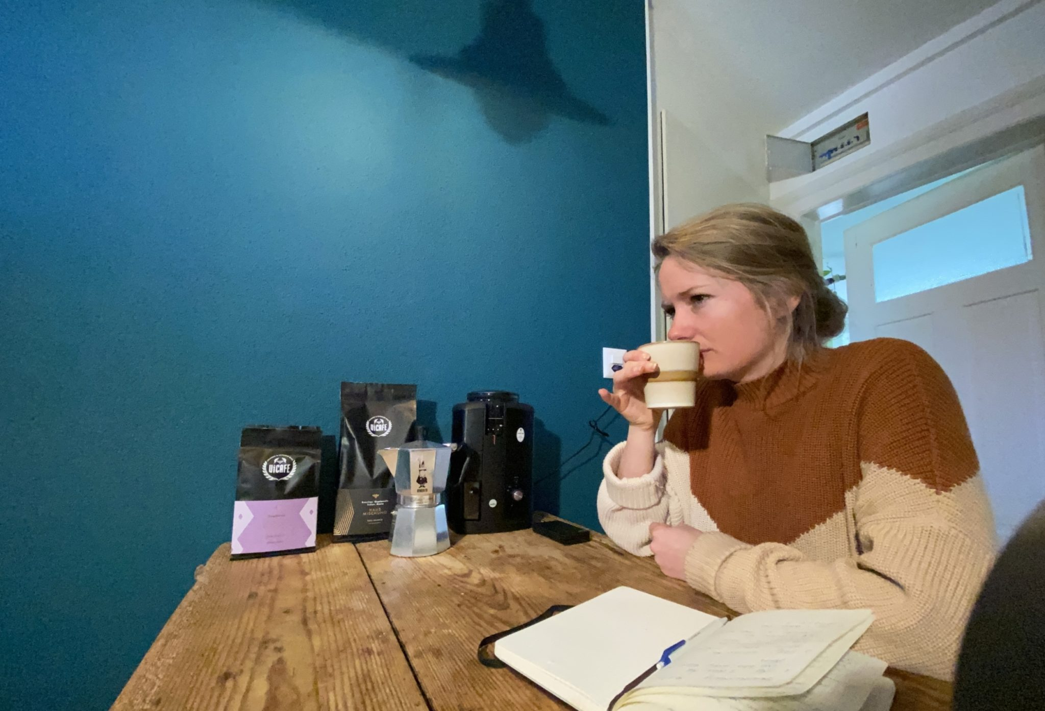 Person testing ViCAFE coffee at home