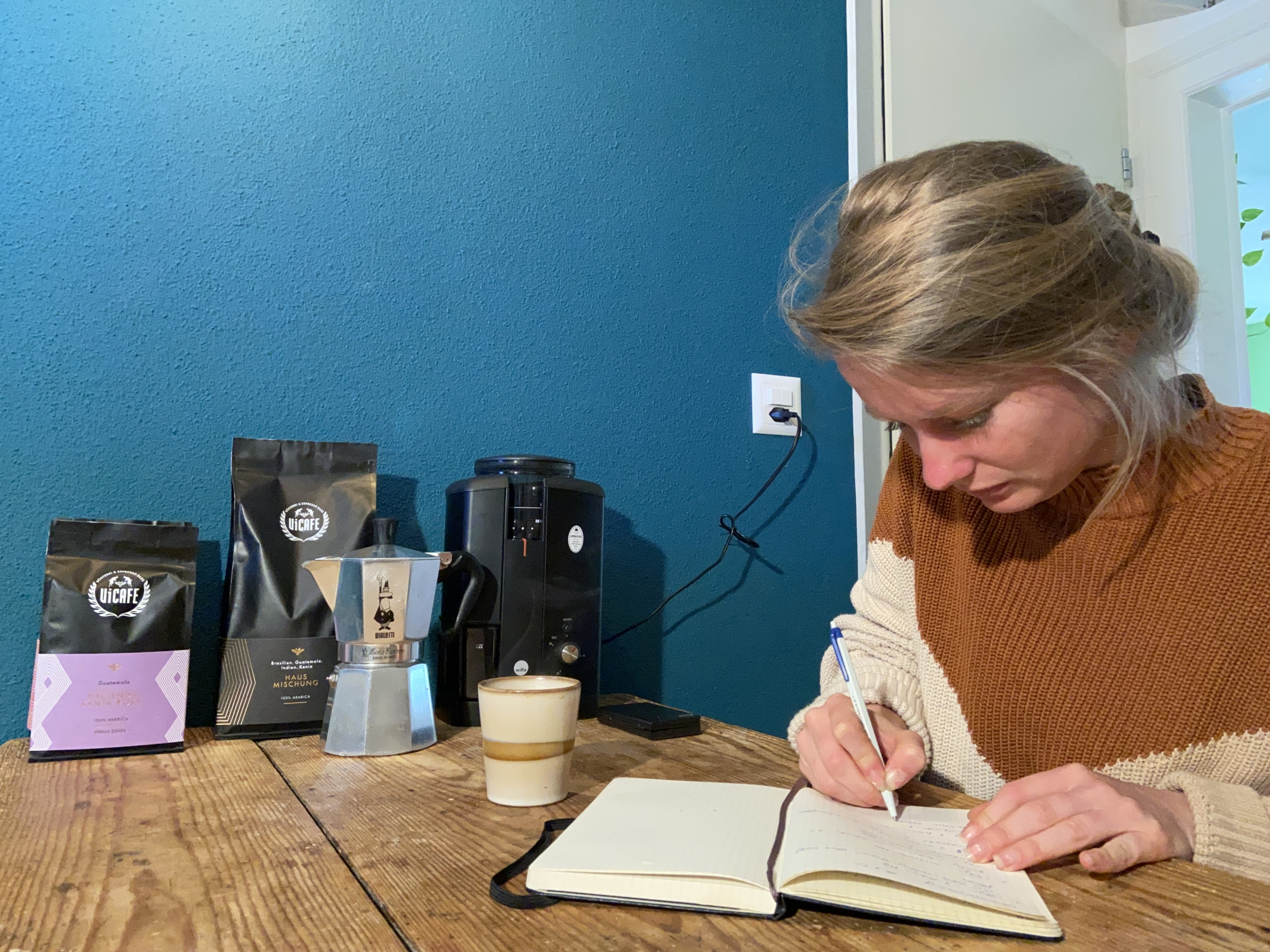 barista taking notes to brew the best coffee