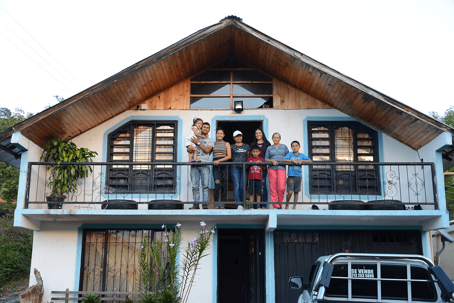 colombian family in front of their house